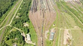 wagons : Branches of the railway at the marshalling yard, a lot of freight wagons from the height. Wagons with coal moving on rails Stock Footage