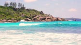 small waves and white beach at Seychelles islands. La Digue, Anse Cocos.