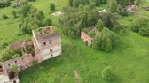 Ruins of the old orthodox church in an abandoned village in the middle zone of Russia, Vologda region. view from above Wideo