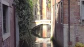 венето : Europe. Italy. Venice. Beautiful narrow street and bridge over the canal in Venice