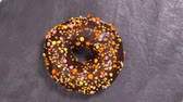 cukiernia : Sweet donut rotates on a dark background. Traditional American sweetness