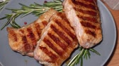 pork meat : Hot meat. Pieces of grilled pork rotate on a plate