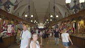 クラクフ : Krakow, Poland June 2019: Tourists at Krakow cloth market 動画素材