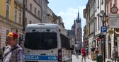 city lifestyle : Krakow, Poland June 2019: tourists walking in the historic center of the city. timelapse