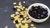 kukoricapehely : bowl of blackberries, blueberries and cereal. morning natural breakfast