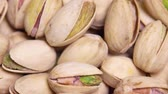 kernels : close up. macro. Fried pistachios in a shell rotate in a circle. background