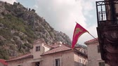 adriai : Kotor, Montenegro. Flag of Montenegro on the facade of the building in Kotor