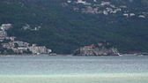 santi : View from afar on the island-hotel Sveti Stefan in Montenegro