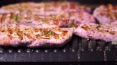 pork meat : Close-up of pork production. Pork steak fried on a grill Stock Footage