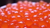 luksus : red caviar close-up. rotation of the caviar in the bowl