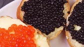luksus : appetizers with red and black caviar close up rotate on a plate
