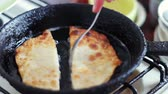 preparation : Pasties cheburek with meat fried in sunflower oil in frying pan