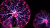 gamma : Closeup view of plasma ball with moving energy rays inside on black background