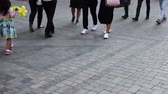 second avenue : Feet of people passing by. The crowd is walking along the street Stock Footage