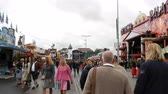 gelenek ve görenekler : September 17, 2017 - Munich, Germany: The largest beer festival in a world Oktoberfest. People in national Bavarian suits Lederhose and Dirdln walk around amusement rides at Theresienwiese