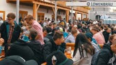 кренделек : September 17, 2017 - Oktoberfest, Munich, Germany: People resting, laughing having fun and sit drinking beer from huge glass mugs at Theresienwiese in Bavaria at the World Beer Festival