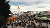 кренделек : September 17, 2017 - Oktoberfest, Munich, Germany:View of the huge crowd of people walking around the Oktoberfest in national bavarian suits, on Theresienwiese, top view