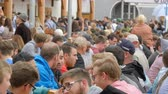 кренделек : September 17, 2017 - Oktoberfest, Munich, Germany:Lot of people are sitting in birgarten drinking beer from beer mugs communicate and have fun Стоковые видеозаписи