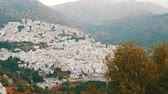 salvador : Many white houses are high in the mountains,panoramic view,Stunning beauty of the white villages of Andalusia in Spain. Stock Footage