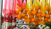 orchidea : Beautiful yellow Thai flowers on colored tapes. Exotic flowers of Asia for offering Buddha