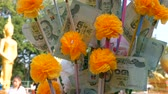 inflation rate : Thai money baht. Banknotes in nominal value of 20 baht. Paper money on Buddha statue background Stock Footage