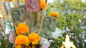 earn : Thai money baht. Banknotes in nominal value of 20 baht. Paper money on Buddha statue background Stock Footage