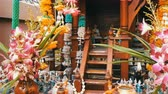 просветление : Beautifully decorated traditional Buddhist altar in the garden in Thailand, with flowers and various symbolic figures