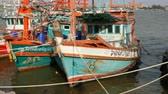 paluba : PATTAYA, THAILAND - DECEMBER 25, 2017: A large number of wooden fishing boats are moored on quay