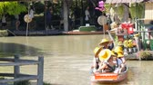pattaya : PATTAYA, THAILAND - December 18, 2017: Different boats with tourists riding them on the river in a floating market Stock Footage