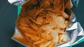 fornada : Teenager takes with the hands potato chips in packs