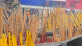 алтарь : Large number of yellow sticks of good luck smoke in front of the altar. Religion Buddhism in Asian countries