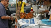 rántott : PATTAYA, THAILAND - DECEMBER 17, 2017: Father and son choose food from a street vendor. Street food of Thailand. Fried chicken pieces in batter.The seller on the street is selling an exotic dish
