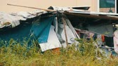 township : Old broken awning for poor people. Poor people live in dirty huts. The problem of the rich and poor in the world