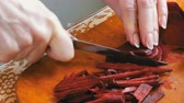 root vegetable dish : Female hands cut beets on home kitchen board