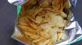 fattening : Teenager boy eats potato chips from a package. Unhealthy food, fast food