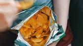 overeating : Teenager takes with the hands potato chips in packs