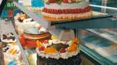bolo de queijo : Tasty beautiful colorful cakes on a storefront. Decorated cakes are sold. Prolblem of diabetes and not healthy food
