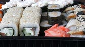 sashimi : Stylish fresh sushi set with various kinds of sushi rolls, close up