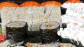 сакэ : A lot of different Nigiri Gunkan Maki Sushi with eel salmon Philadelphia cheese cucumber close up view