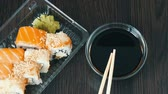 different kinds : Transparent plastic container with variety of sushi rolls from the national Japanese cuisine