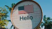 shabby : Beautiful sign with American flag with the inscription Hello in English. Sign with the words hello Stock Footage
