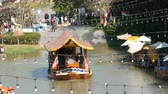 exciting : PATTAYA, THAILAND - December 18, 2017: Large group of tourists swim along the river on boats visiting the sights of the floating market