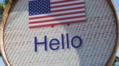 вывеска : Beautiful sign with American flag with the inscription Hello in English. Sign with the words hello Стоковые видеозаписи