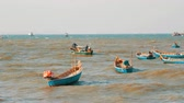 копье : Small fishing boats sail along the lush sea on waves. Fishermen catch fish in the sea