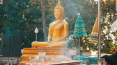 agyar : PATTAYA, THAILAND - December 18, 2017: Many delicate aroma sticks of a good luck stand and haze in front of the Buddha statue. Hill of the Great Buddha, Pattaya Stock mozgókép