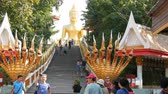азиатский : PATTAYA, THAILAND - December 18, 2017: Tourists visiting BIg Buddha Hill, an attractive place .A huge image of Buddha at the top of hill. Majestic stairs with statues of dragons
