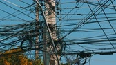 main line : Tangled bundles of overhead wires. Electricity system on streets of Pattaya, Thailand. Tangle of wires on overloaded utilities pole in Thailand wire level pan