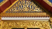 bem aventurado : Beautiful ornament of a Buddhist temple. The golden frame and decor of authentic Thai temple