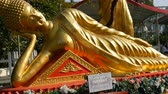 asian architecture : Golden statue of reclining Buddha in a temple complex of Big Buddha Pattaya, Thailand Stock Footage