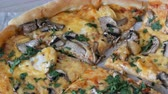 sausage slice : Womans hand takes piece of round pizza withwith greens, chicken, mushrooms and double cheese Stock Footage